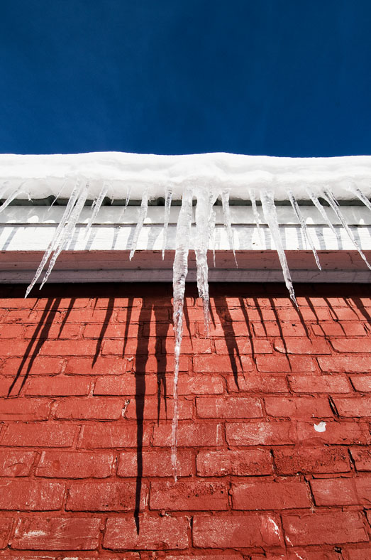 Icicles on red brick