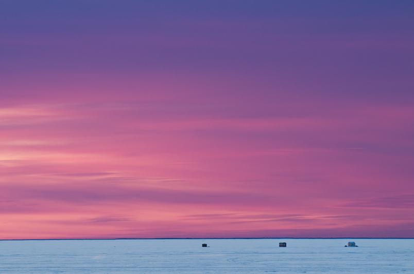 Ice fishing huts at sunset - Lake Nipissing - North Bay